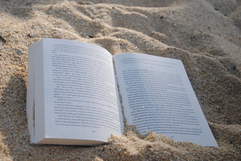book laying flat on the beach