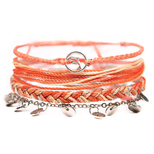 orange dolphin string bracelet stack