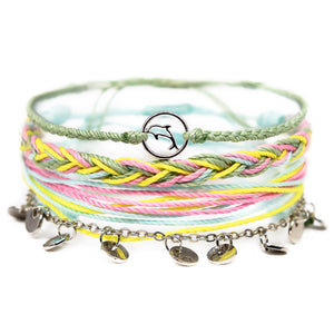 pastel green and yellow dolphin string bracelet stack