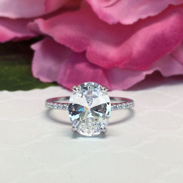 3.25 ctw Oval Accented Solitaire Ring