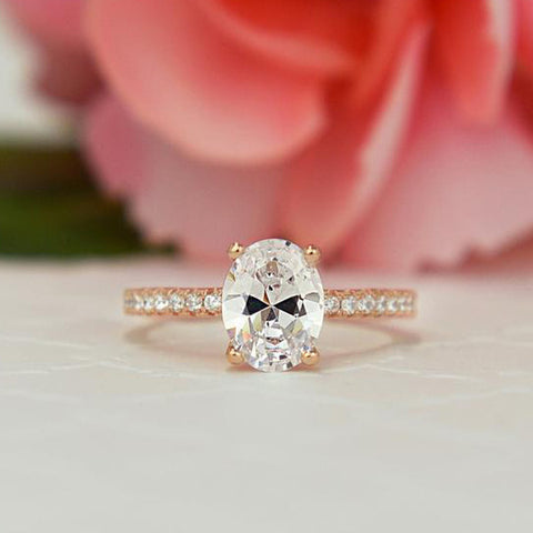 1.25 ctw Oval Accented Ring