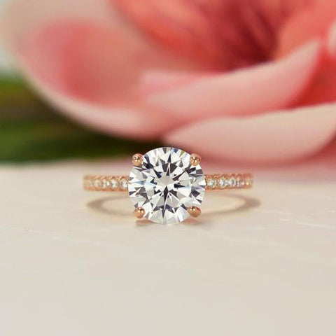 2 ctw Pear Accented Solitaire Ring