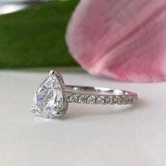 1.5 ctw Pear Accented Solitaire Ring
