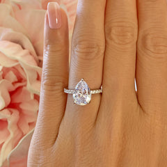 3.25 ctw Pear Accented Solitaire Ring