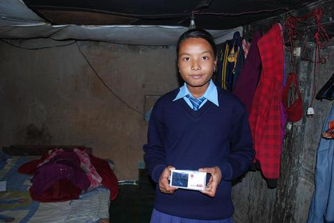 Give Light Nepal LuminAID Boy Home