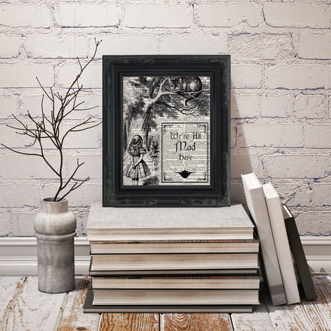 An image of a framed Dictionary Art Print resting on books.