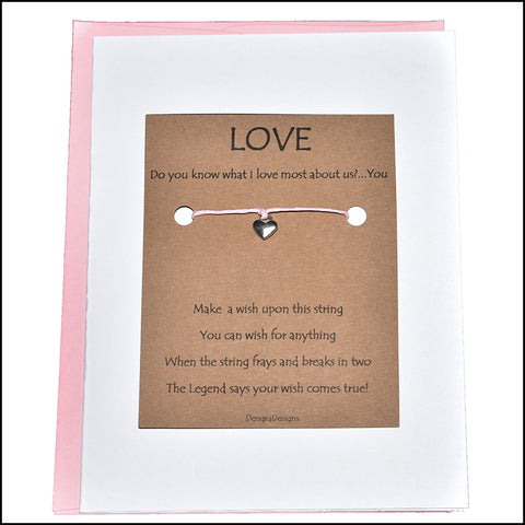 An image of a(n) Love You the Most with Heart Charm Charmed Greetingl.