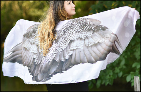 An image of a(n) Grey and White Spotted Wing Span - Scarf.