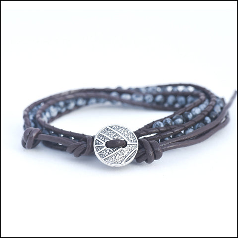 An image of a(n) Snowflake Obsidian - Semi Precious Stones and Leather Wrap Bracelet.