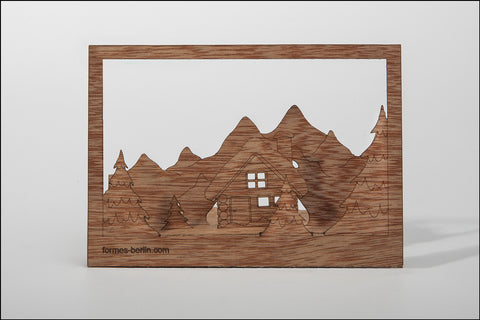 An image of a(n) Winter Log Cabin - Wooden Postcard.