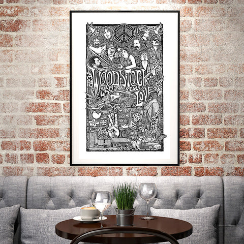 An image of a framed Letterpress Posterography Art Print in a living room.