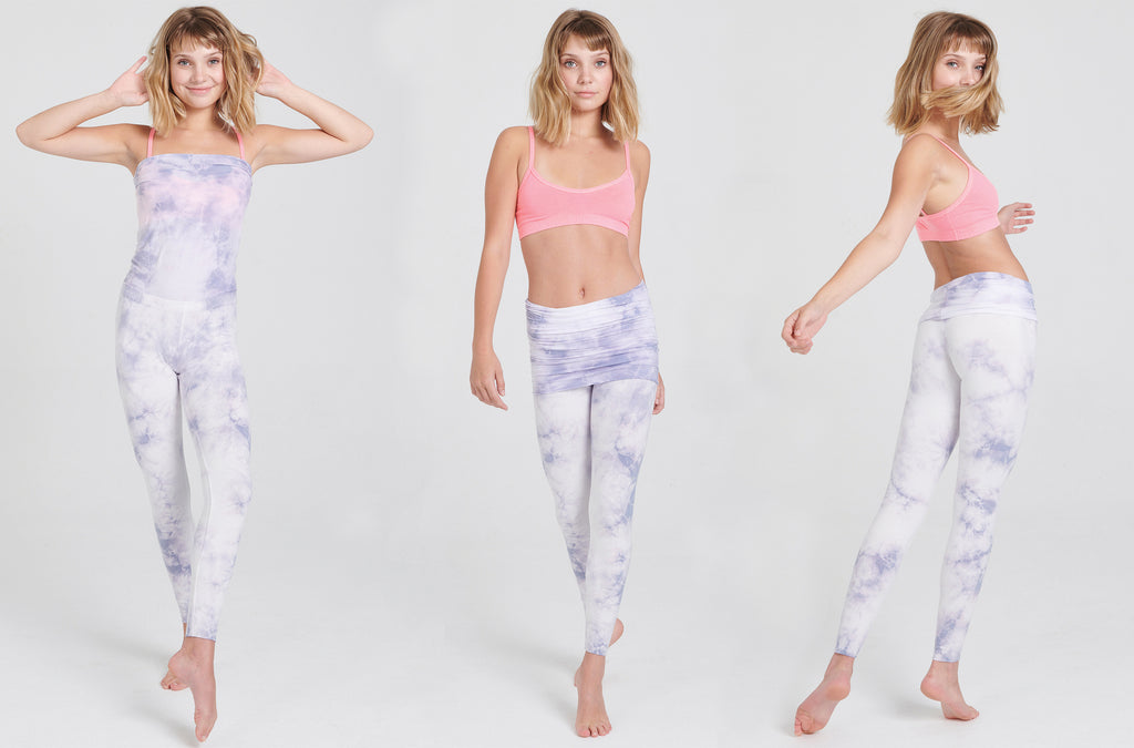 Tie Dye Amethyst Crystal Wash is pale purple on White. Nomad skirted legging shown as a bandeau jumpsuit, long foldover and waistband foldover. Styled with the Asana Bra in Pink.
