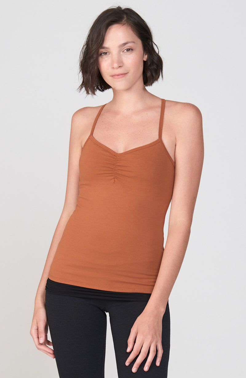 The Practice Cami in a gorgeous Rust color. Organic cotton lycra fitted cami with shirring at the bust and spaghetti straps.