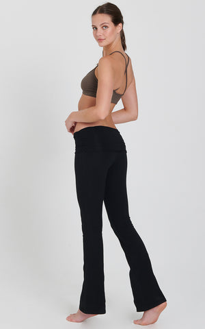 Back view of bootleg flare yoga activewear pant with shirred waistband details.