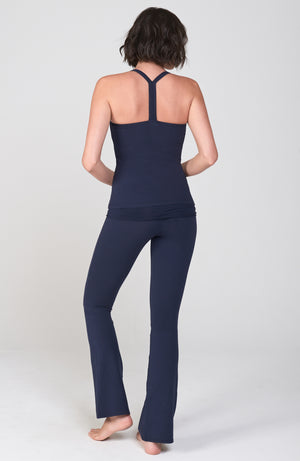 Back view of Navy Blue Organic cotton lycra bootcut Activewear pant with flare leg. Shirred detail waist overlay. Worn with matching Navy T back Active Tank.