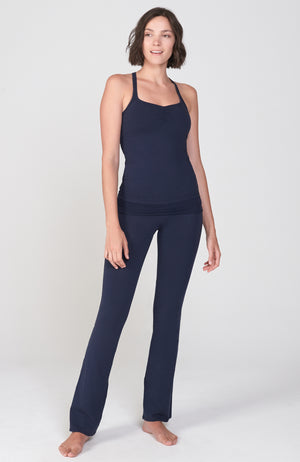 fitted Navy Blue Organic cotton lycra bootcut Activewear pant with flare leg. Shirred detail waist overlay. shown with matching Navy Racerback workout tank.