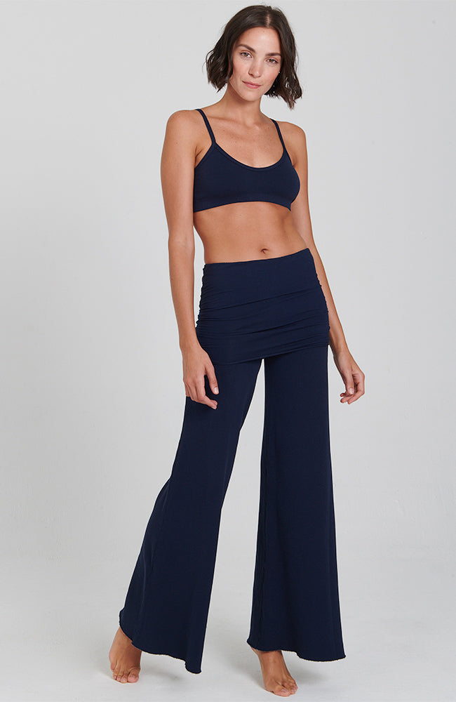 front view of Navy Blue cozy wide leg pant with flared bottom and slim foldover 'skirt' waistband.