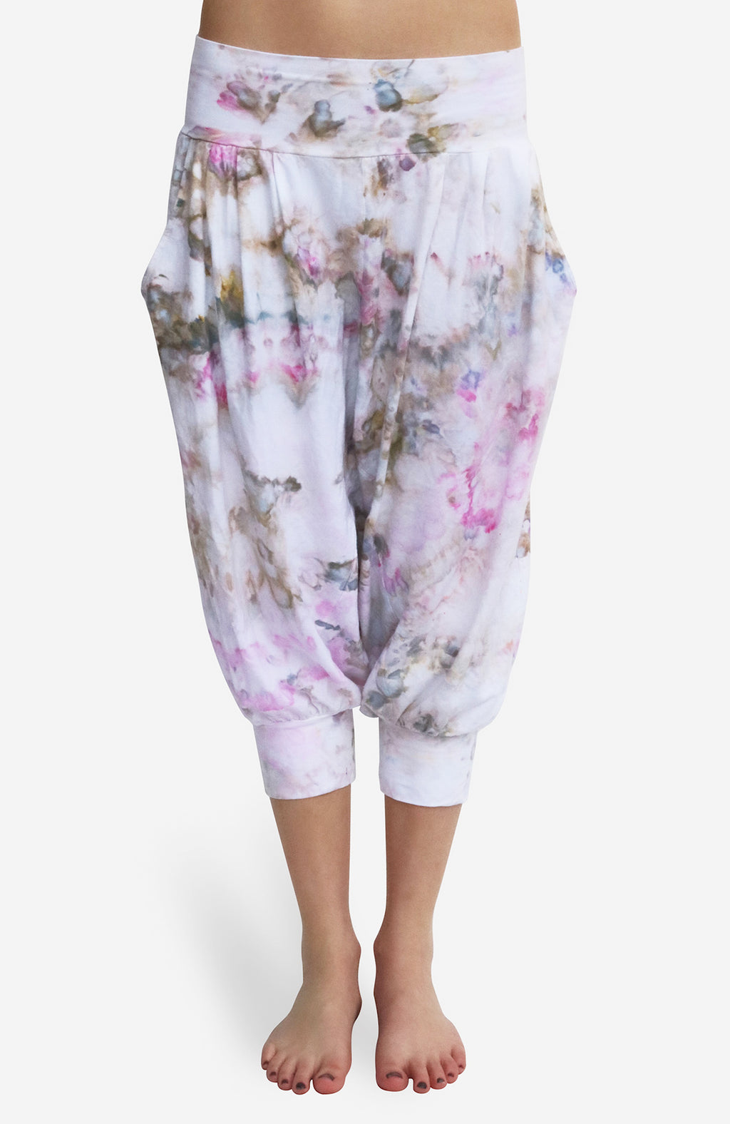 Hand Dyed Harem Capri pant in lightweight cotton lycra has a fluid drape and deep pockets. Spring rain is a floating mux of pinks and moss green and teals sparingly over a white background.