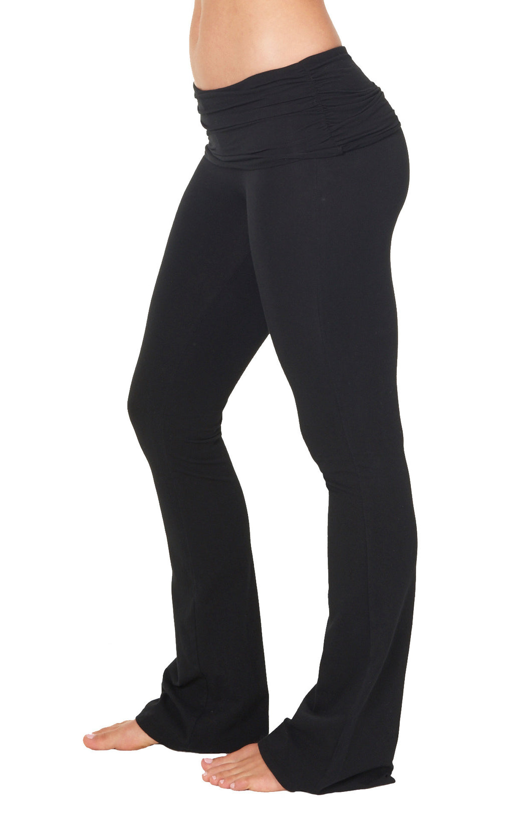 Side view of fitted Black Organic cotton lycra bootcut flare  pant with shirred detail waist overlay.