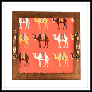 Wooden tray with multiple colourful camels in an orange background. The tray is hand embellished with crystals suitable for gifting and home decor.