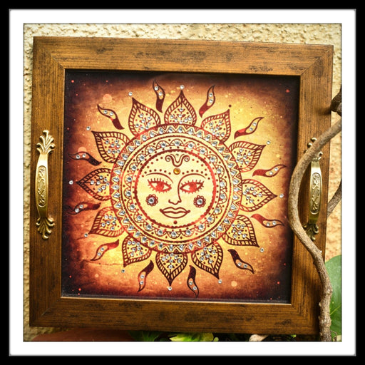 Wooden rust and brown tray with a Sun God Print in batik style The tray is hand embellished with crystals suitable for gifting and home decor.