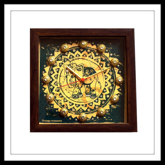 decorative clock with vintage blue elephant print and  brass stones