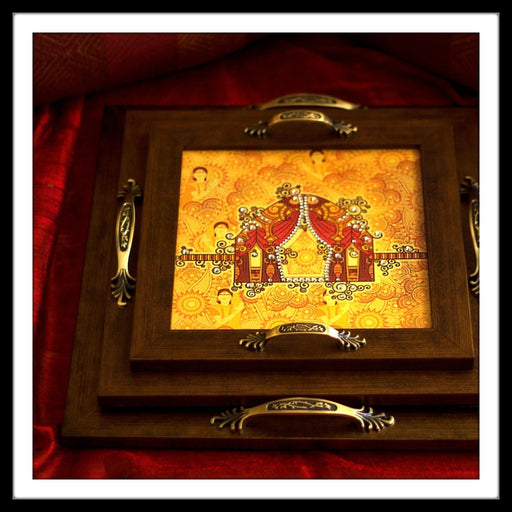 set of 3 handmade hand embellished wooden trays with the print of an wedding palanquin (palki) in red and yellow colours