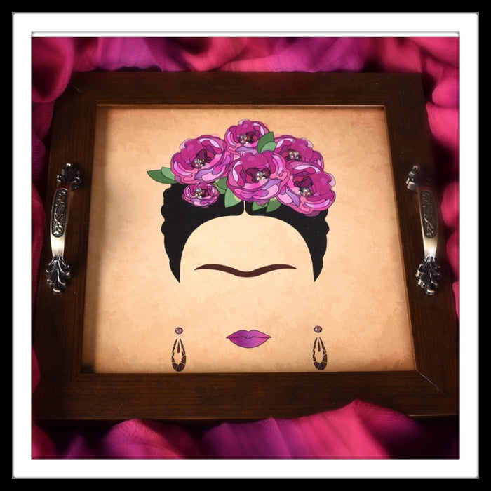 Handmade bright tray with the image of Frida Kahlo on a beige background, Frida has pink flowers in her hair.