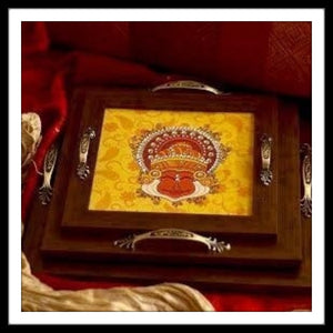 set of 3 handmade hand embellished wooden trays with the print of natraj in red and yellow colours