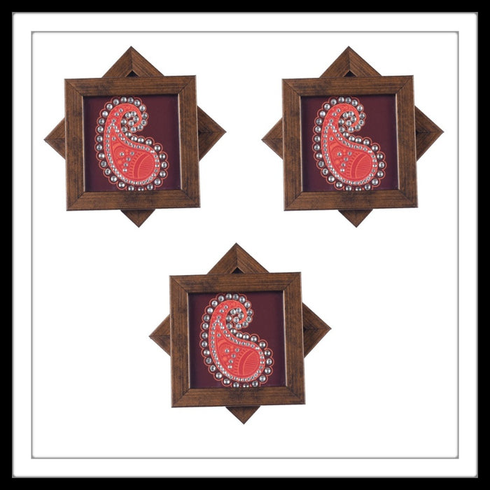 Handmade maroon coasters set with paisley print and crystal work, suitable for gifting and weddings