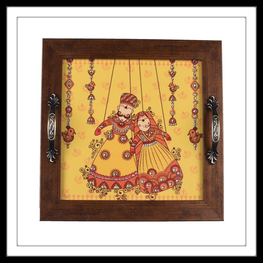Handmade wooden tray with the image of Rajasthani Puppets on yellow background with embellishments