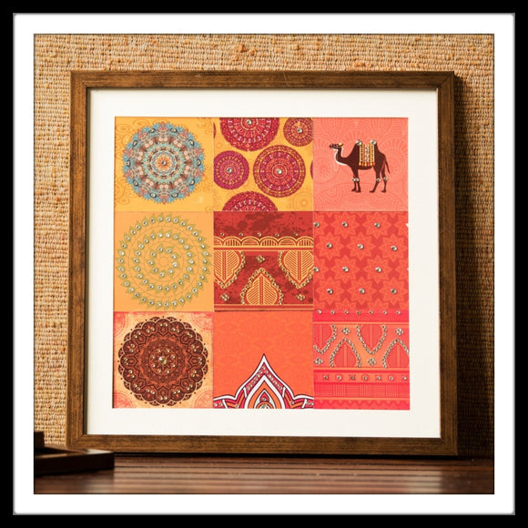 Mosaic wall art with bedazzled camel and mandala prints in shades of red and orange