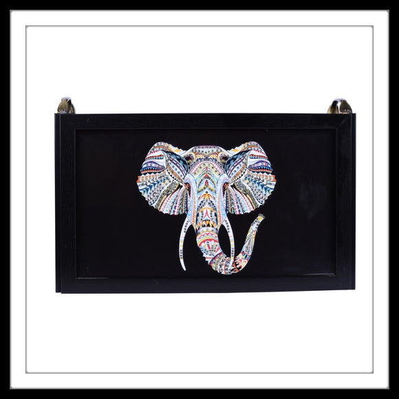 magazine rack with black elephant print bedazzled with diamante