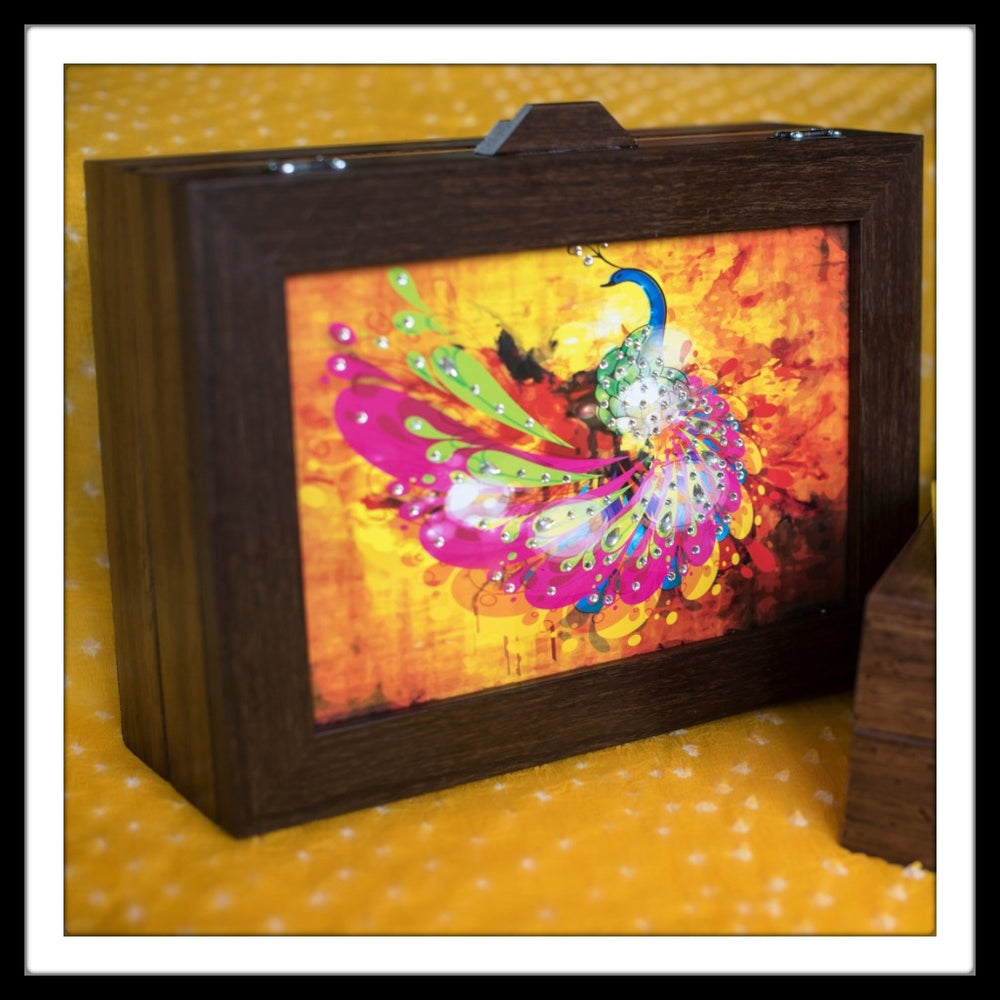 bedazzled yellow and pink Peacock multipurpose box for home decor and gifting.