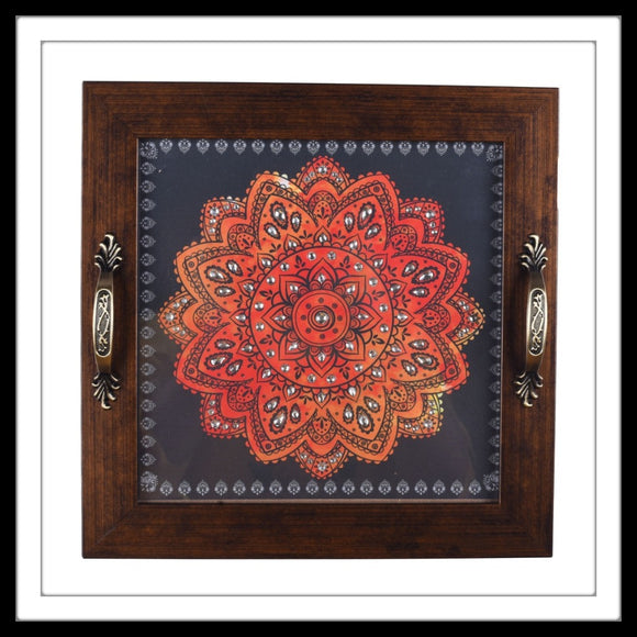 handmade embellished  tray with orange mandala on grey background for home decor or gifting