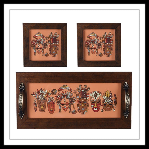 set of hand embellished tray and two coasters with aztec masks print in rust background