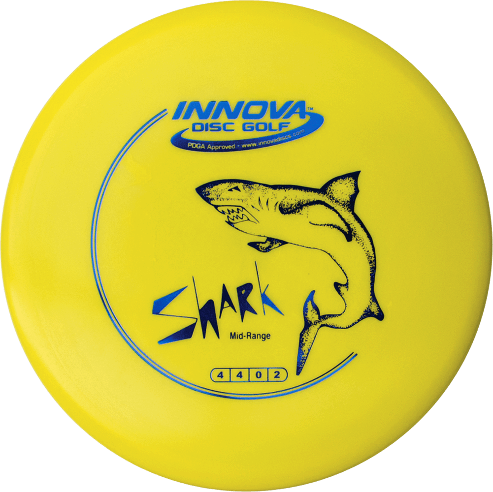 An image showing Innova Shark - DX Plastic, yellow in color. Shark design, a disc golf for frisbee