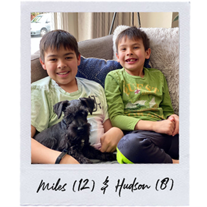 Robyn's kids Miles and Hudson relaxing with their dog on the couch