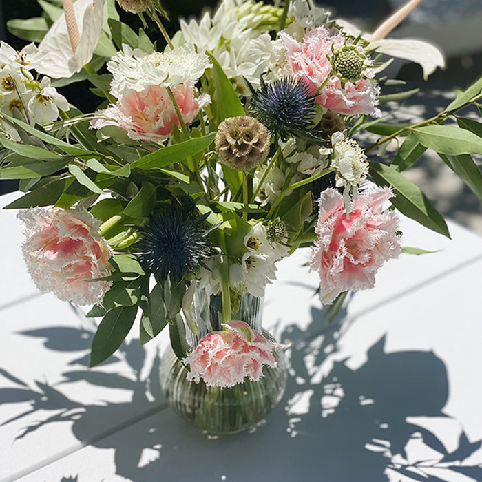 arrangement of white and pink flowers
