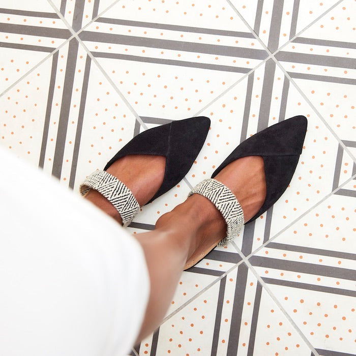 black slides with zig-zag patterned cuff