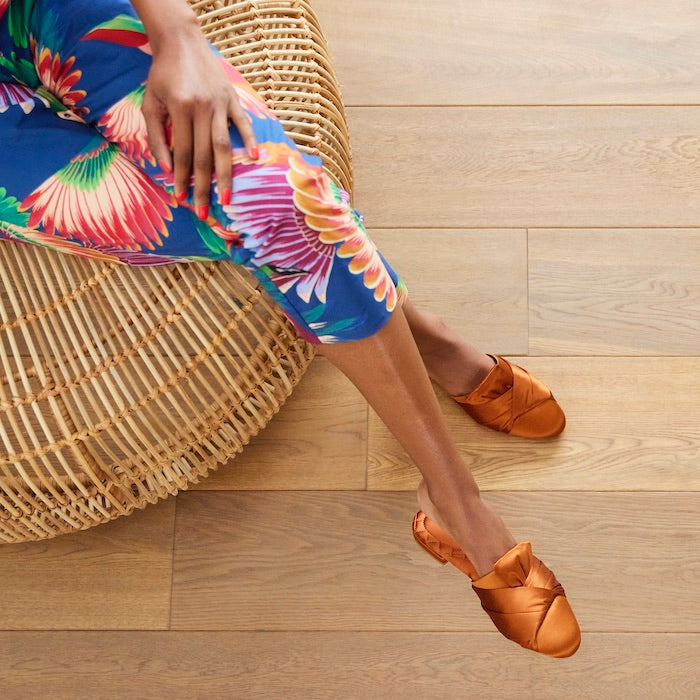orange slides with colorfully printed jumpsuit