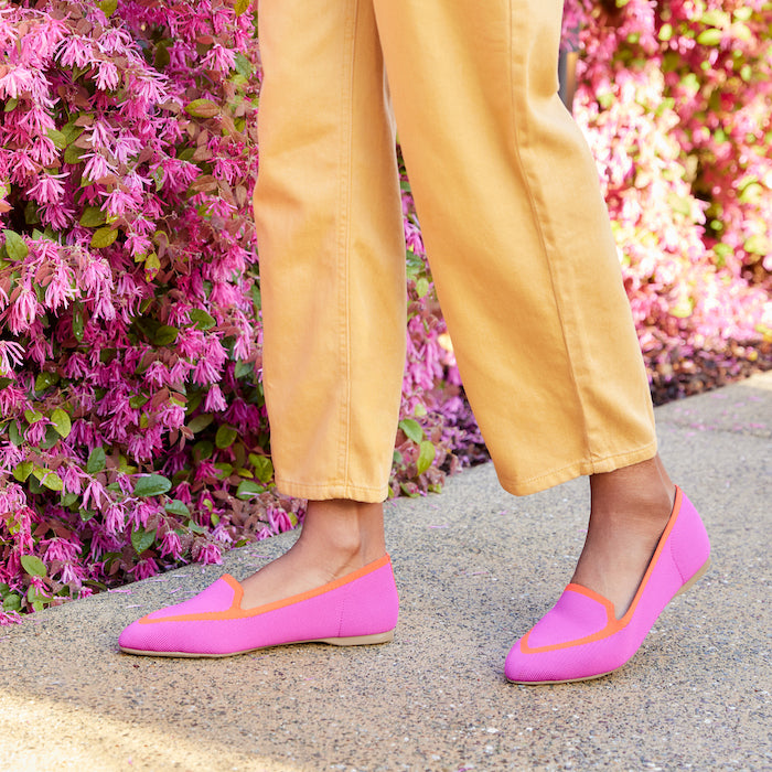 woman wearing hot pink flats with yellow wide-leg pants