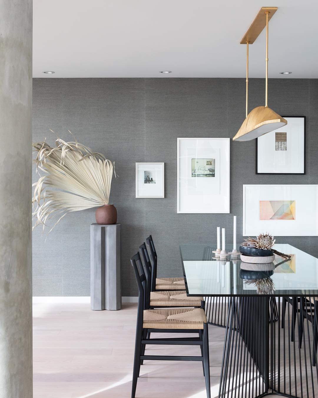 Modernly designed dining area with gray paint and gallery wall