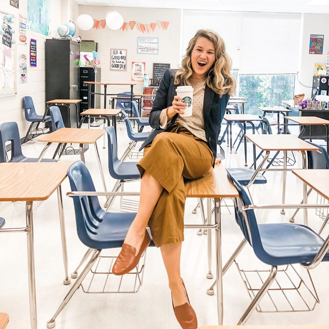 teacher in classroom wearing cognac leather flats