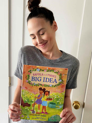 Meena holding Kamala & Maya Big Ideas book