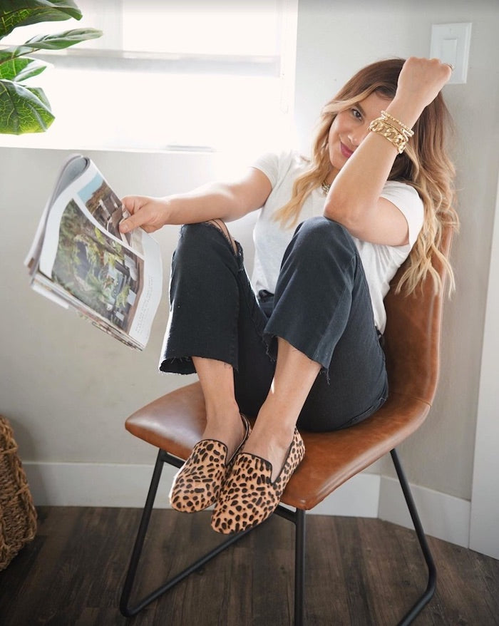 cheetah-print flats with black jeans and a white t-shirt