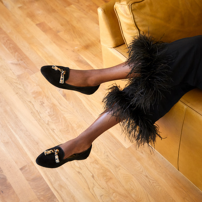 black suede flats with cheetah tassel and black feather pajama pants