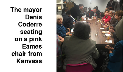 The mayor Denis Coderre seating on a pink Eames chair from Kanvass