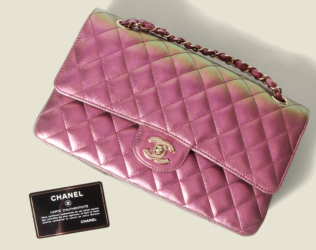 Detail image of iridescent Chanel bag with authenticity card.