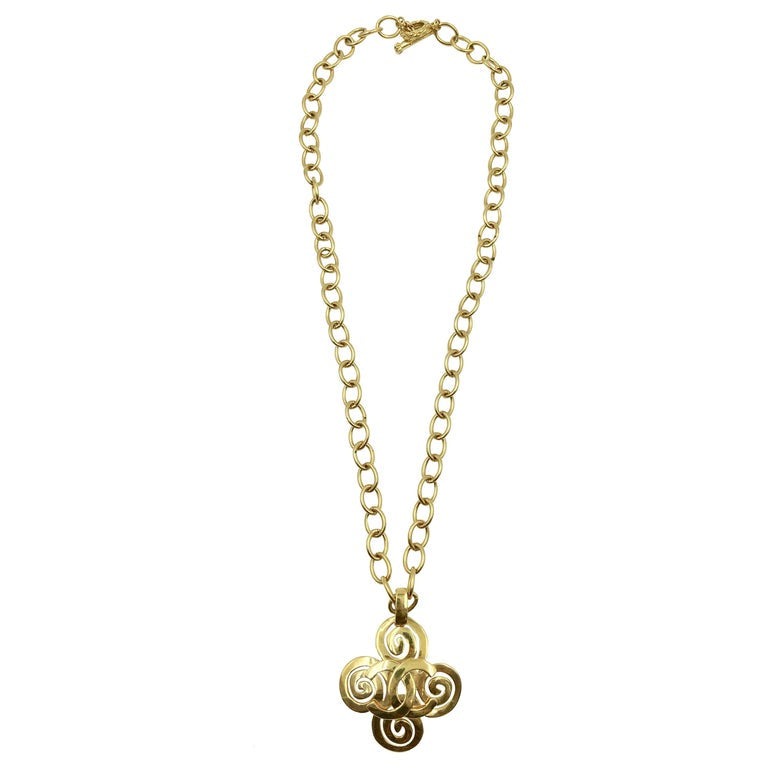 ee5e73fe05cf8b Chanel Gold Tone CC Logo Swirl Cross Necklace – catwalk